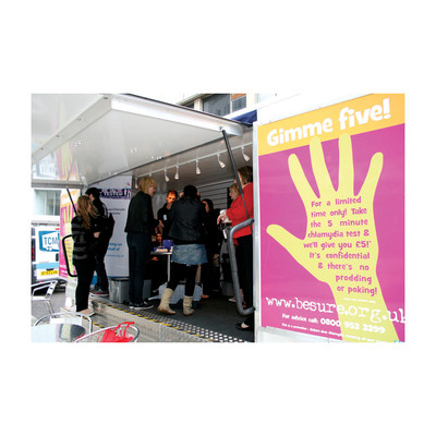 Health Trailer, health messages and testing group of young people interacting inside trailer large posters, Health Edco, 37500